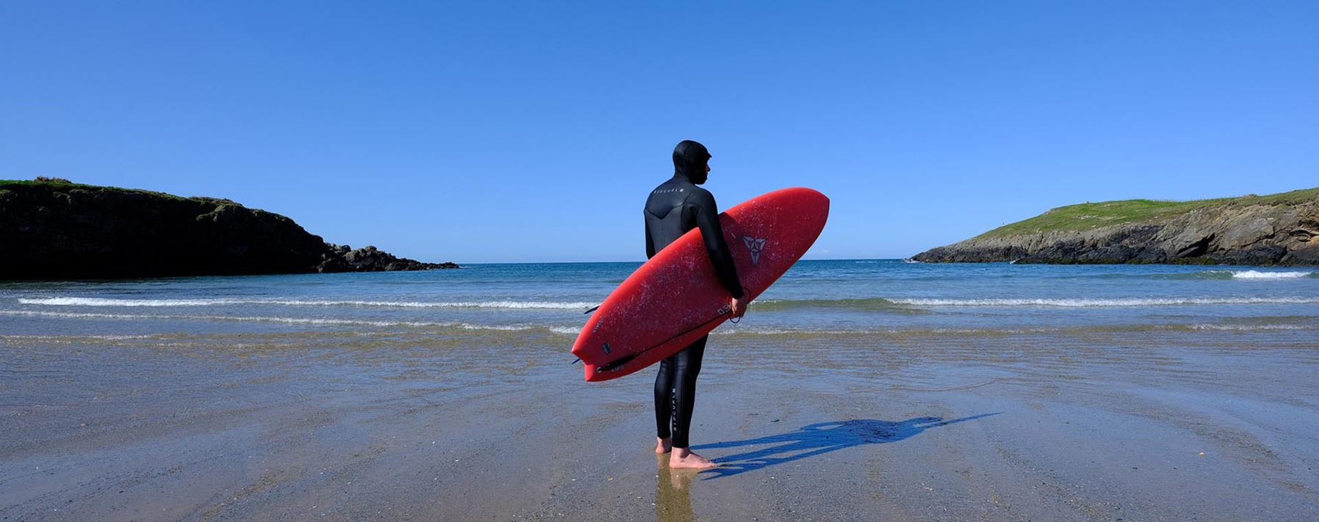 Surfing on a beach in North Wales