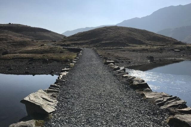 Snowdon route crossing the lake with mountains in the background