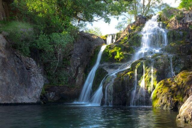 Stunning waterfalls cascading into crystal clear pool